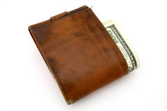 Wallet. Money on a worn wallet over a white surface Royalty Free Stock Photography