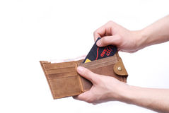 Wallet. Dishing out cash from a leather wallet to pay bills Royalty Free Stock Photography