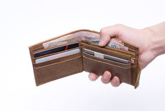 Wallet. Dishing out cash from a leather wallet to pay bills Royalty Free Stock Photo