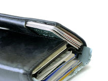 Wallet. Partial stuffed wallet shallow dof stock photo