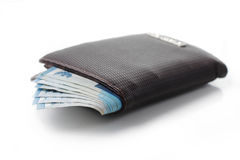 Wallet And Money Over White Royalty Free Stock Images