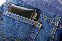 Wallet in back pocket. Wallet showing in back pocket of jeans royalty free stock photography