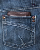Wallet in the back pocket of a demin pant. Wallet in the back pocket of a jeans Royalty Free Stock Images