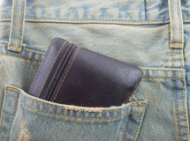 Wallet in a back pocket of a denim jeans as a background. Pocket  jeans  background Wallet back Royalty Free Stock Image
