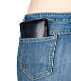 Wallet in back pocket of jeans. On white background royalty free stock image