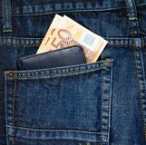 Wallet in a back pocket of a jeans Royalty Free Stock Photography