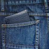 Wallet in a back pocket of a jeans Stock Image