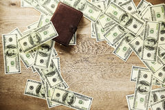 Wallet and Bank banknotes spread out on the table Stock Photos