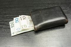 Wallet with banknotes being a means of payment in Poland or Poli. Black men`s wallet with banknotes being a means of payment in Poland or Polish Zloty Stock Photography