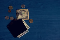 Wallet banknotes and coins Royalty Free Stock Image