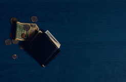 Wallet banknotes and coins Stock Image