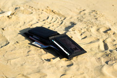 Wallet in the beach Royalty Free Stock Photo