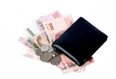 Wallet with bills and coins Royalty Free Stock Photos
