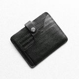 Wallet. Black leather wallet lying on a white table Stock Photos