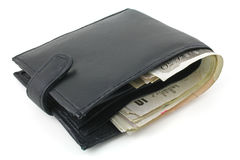 Wallet. A black wallet with sterling notes isolated on a white background Royalty Free Stock Image