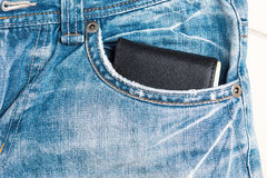 wallet on blue jean pocket Stock Photo