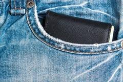 Wallet on blue jean pocket Stock Images