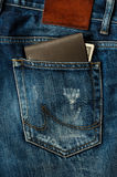 Wallet brown in jeans pocket Stock Photo