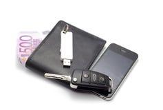 Wallet, car key, smartphone. Image of thr wallet, smartphone, car key Stock Image