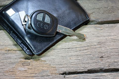 Wallet and car key. On the wooden floor Royalty Free Stock Images