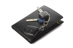Wallet and car keys. Wallet and keys for car on the white background with shadow Royalty Free Stock Images