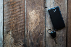 Wallet , car keys and mobile on a wooden floor Royalty Free Stock Image