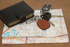 Wallet and car keys on the road map, concept travelling Royalty Free Stock Photos