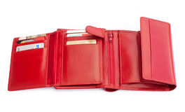 Wallet with cards. Red wallet with credit and debit cards, isolated over a white background royalty free stock photo