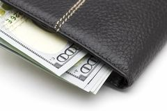 Wallet with cash. Black leather wallet with cash dollars on a white background Royalty Free Stock Photos