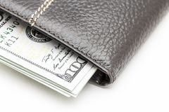 Wallet with cash. Black leather wallet with cash dollars on a white background Royalty Free Stock Images