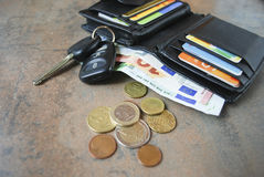Wallet with cash, cards, car keys on the table. Stock Photo