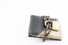 Wallet with chain and padlock. Concept of saving, not spending money. White background Royalty Free Stock Photography