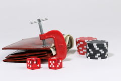 Wallet in clamp - poker chips and dice Royalty Free Stock Image
