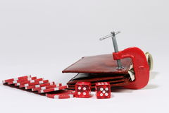 Wallet in clamp - poker chips and dice Royalty Free Stock Images