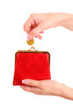 Wallet and coin in woman hand. Red wallet and coin in woman hand over white background Stock Photography