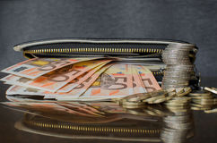 Wallet with coins and banknotes. Black  wallet with euro money Royalty Free Stock Photography