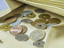 Wallet and coins Stock Photography