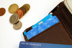 Wallet with credit card and coins. On white background stock photo