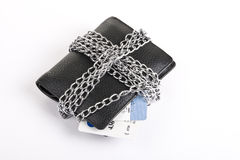 Wallet and credit card tied with chain. On white background Royalty Free Stock Images