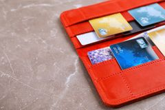 Wallet with credit cards on table Stock Image