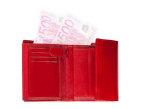 Wallet with disappearing euros. Red wallet with two semi-transparent five-hundred-euro banknotes isolated over a white background stock photos