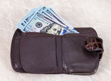 Wallet with a dollar bill sticking out. Wallet open with a dollar bill sticking out Stock Images