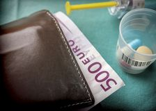 Wallet with dollar next to medicines, concept of copayment healt. H Stock Photography