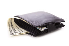 Wallet with dollars. Black leather wallet with dollars and credit cards isolated Royalty Free Stock Image