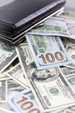 Wallet and dollars Stock Images