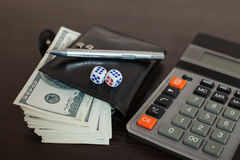 Wallet with dollars, pen and calculator on table Royalty Free Stock Photos