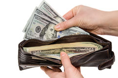 Wallet with dollars in the woman hands. Isolated Royalty Free Stock Photography