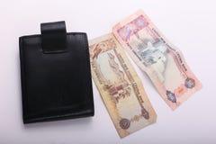 Wallet with Emirates Dirham. On white background royalty free stock photo