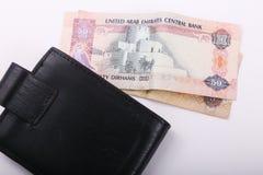 Wallet with Emirates Dirham. On white background royalty free stock photos