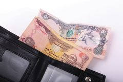 Wallet with Emirates Dirham. On white background royalty free stock photography